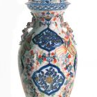 Ornamental vessel with lid
