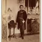 Portrait photograph - Kornél Emmer, judge of the Curia in Hungarian gala costume in the salon of the Emmer Palace, Buda